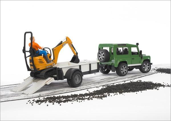 BRUDER bworld Spielzeug Land Rover Defender mit Anhänger CAT Bagger & Mann 02593